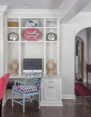 This bookcase, to the side of the kitchen, doubles as a home office. (Bob Greenspan)