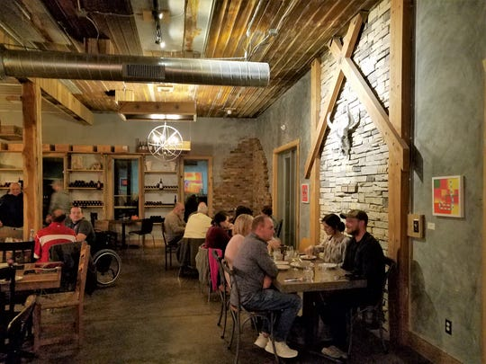 The rustic feel of the new Farmer and Frenchman restaurant blends seamlessly with the rural landscape and rebuilt tobacco barn events Venue.