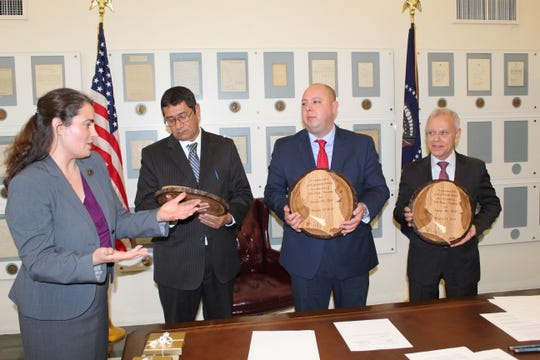 Hayes Presidential Library and Museums Executive Director Christie Weininger presents commemorative sister city plaques to Villa Hayes Mayor Esteban Rios Ayala, left, Fremont Mayor Danny Sanchez, middle, and Paraguayan ambassador German Rojas, left.