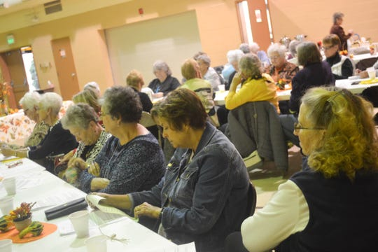 Dozens of women representing several different denominations participate in Church Women United's 2018 World Community Day at St. Ann Catholic Church.