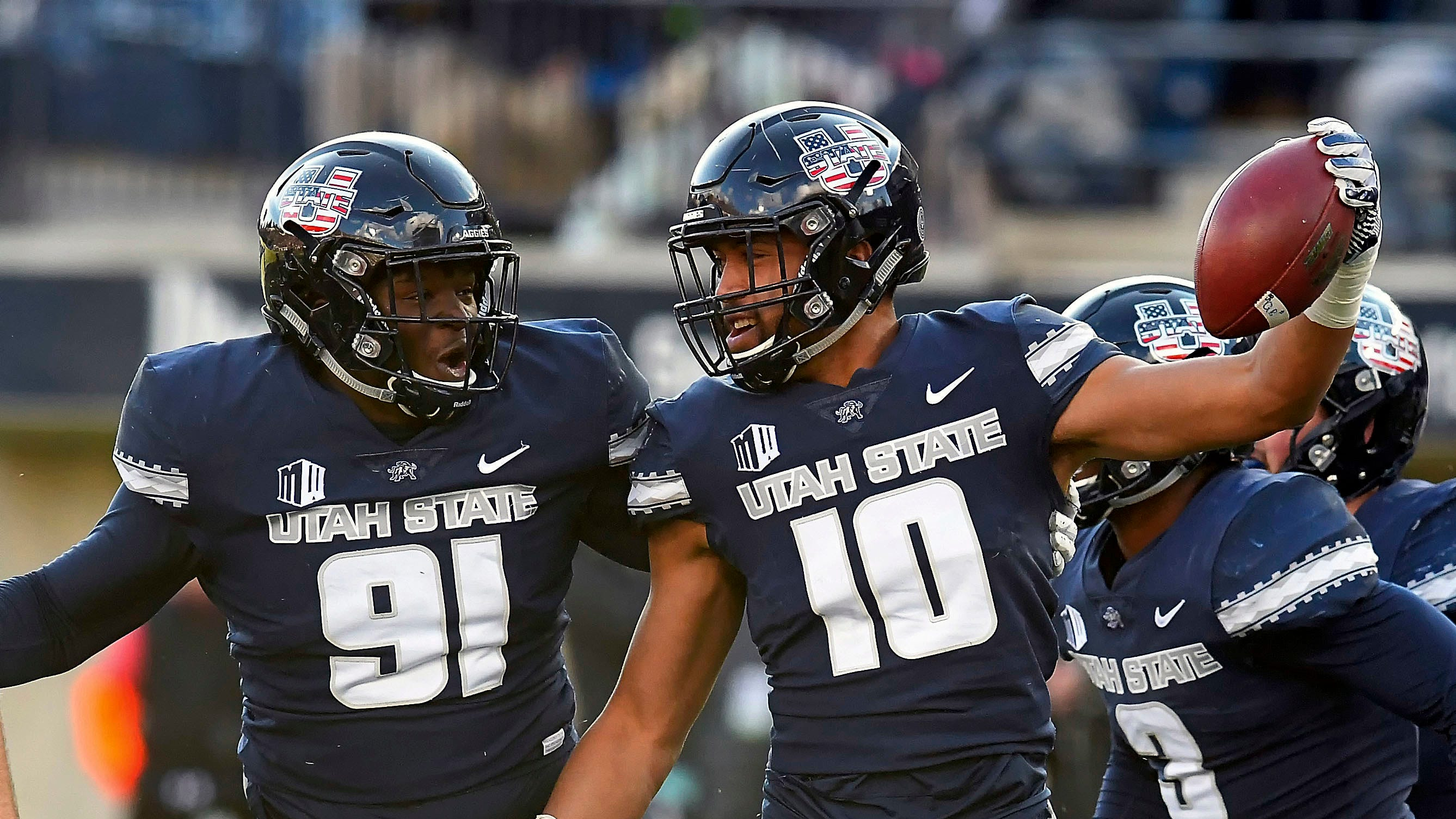 Utah State linebacker Tipa Galeai (10) celebrates with defensive end Devon Anderson (91) after he intercepted a San Jose State pass during an NCAA football game Saturday, Nov. 10, 2018, in Logan, Utah. (Eli Lucero/The Herald Journal via AP)