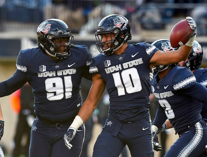 Utah State linebacker Tipa Galeai (10) celebrates with defensive end Devon Anderson after he intercepted a San Jose State pass earlier this season.