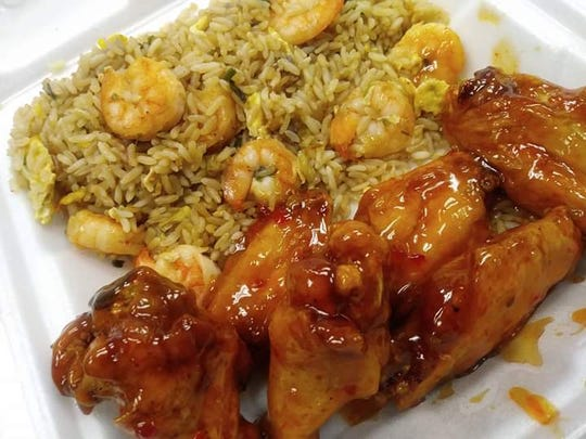 Bourbon chicken with shrimp fried rice is one of the rotating daily specials at Chelle's Special Touch in Fort Myers.