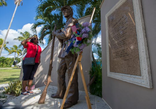 Andrea Grady, Ret. NC (Navy Counsel), and Commander of the Robert H.L. Dabney American Legion Post 192 in Fort Myers, salutes the United States Colored Troops Memorial statue during a Veteran's Day commemorative event at Centennial Park in Downtown Fort Myers, Monday, November 12, 2018. Grady is first female commander at the post. The event, which was put together by the Lee County NAACP and 192nd American Legion Post, commemorated the recent restoration of the United States Colored Troops Memorial. The ceremony also marked the 20-year anniversary since the memorial was originally dedicated and unveiled on Veterans Day in 1998.