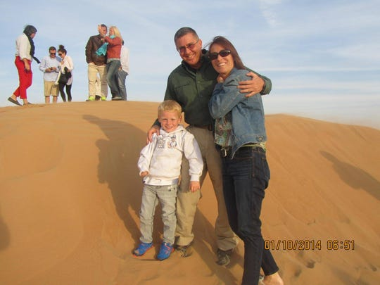 Isaiah Lanphear with parents, Joe and Lisa, on a family vacation in Dubai in 2014.