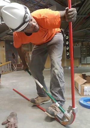 Lamar Brooks Jr. trains on-the-job as an Electrician Apprentice.
