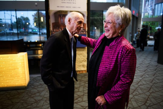 Zan Wells laughs as she speaks with her cousin, former South Carolina Governor and U.S. Secretary of Education Dick Riley, during a statue unveiling at the Peace Center on Monday, Nov. 12, 2018. Wells created the sculpture of Riley that is now on display outside of the Peace Center.