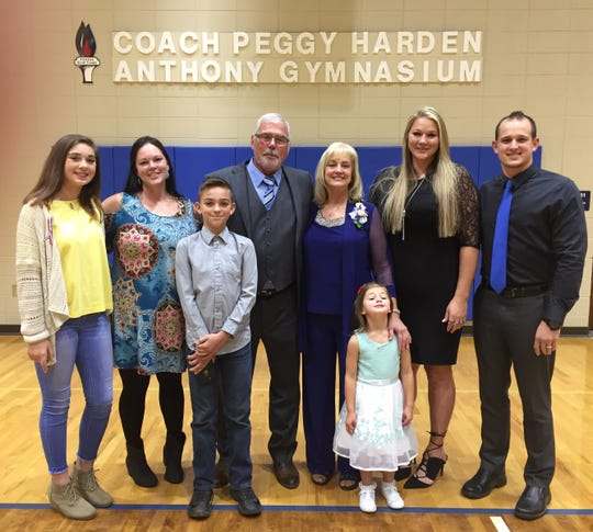 Former Pickens volleyball coach Peggy Anthony poses with her family Sunday following the dedication of the Coach Peggy Harden Anthony Gymnasium.