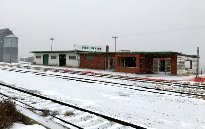 Fort Benton's long-abandoned railroad depot is slowly coming down.