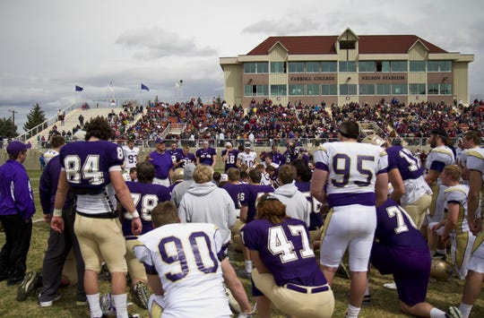 Carroll College Head Coach Mike Van Diest speaks to his team after the Saints wrapped up their portion of the scrimmage double-header Saturday at Nelson Stadium in Helena.
