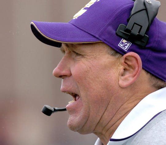 Carroll College head coach Mike Van Diest yells to players on the field during their second round NAIA playoff game Saturday, Nov. 26, 2005.