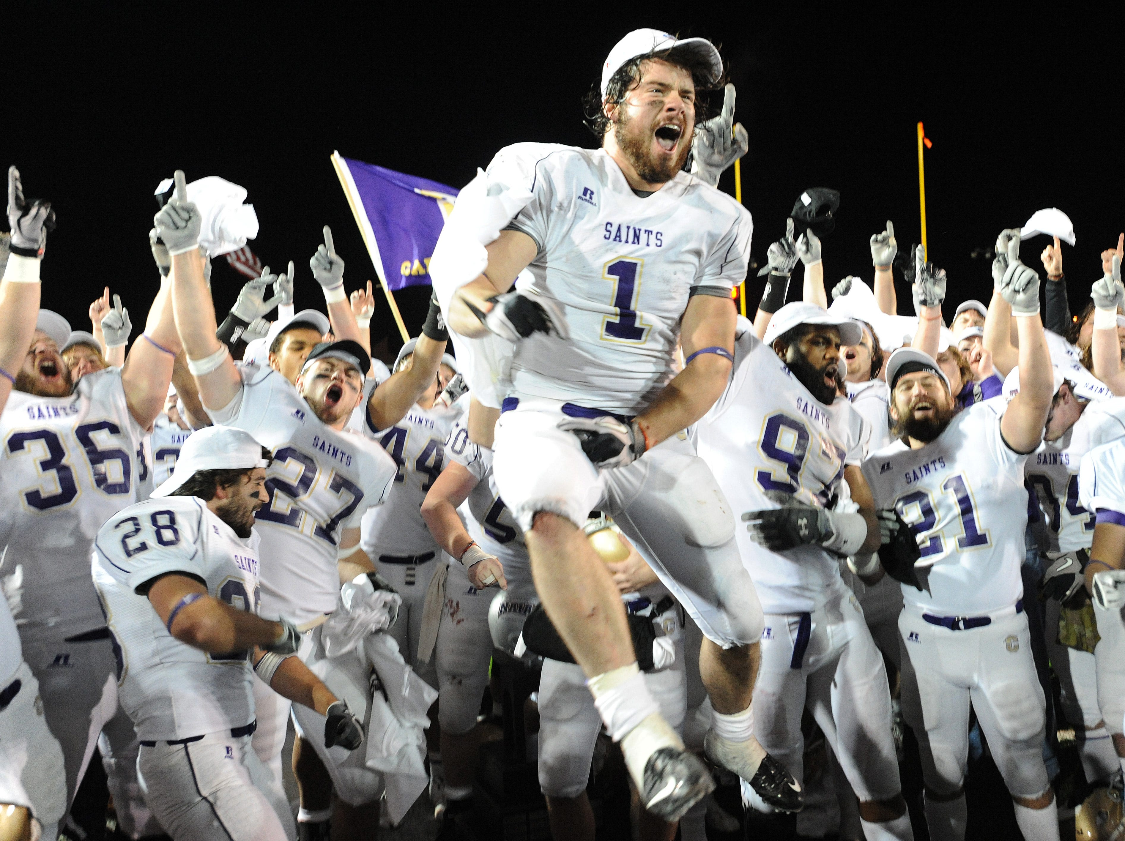 Carroll College running back John Camino (1) and other members of the team celebrate defeating Sioux Falls in the NAIA college football championship game at Brannon Field on Saturday, Dec. 18, 2010, in Rome, Ga. Carroll College defeated Sioux Falls 10-7.