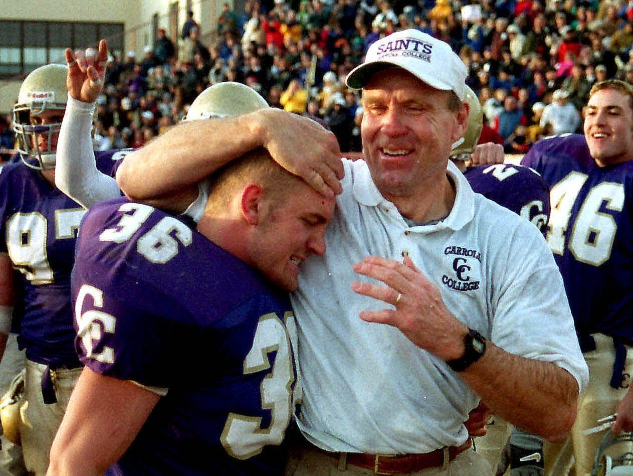 Carroll coach Mike Van Diest, right, shares a moment with linebacker Joe Horne followng the Saints' second-round NAIA playoff win over Huron on Saturday, Nov. 25, 2000, at Vigilante Stadium in Helena, Mont.