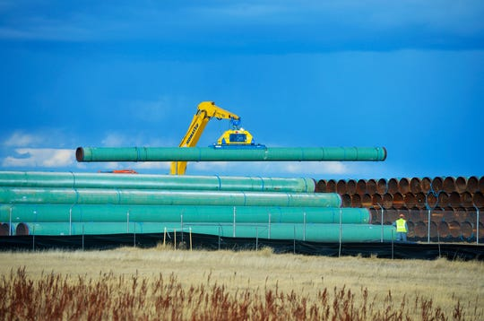 Pipe for the Keystone XL Pipeline is seen being stored at a pipe yard in Phillips County in Montana in 2018. Canadian company TC Energy gave the go-ahead to start the $8 billion project on Tuesday.