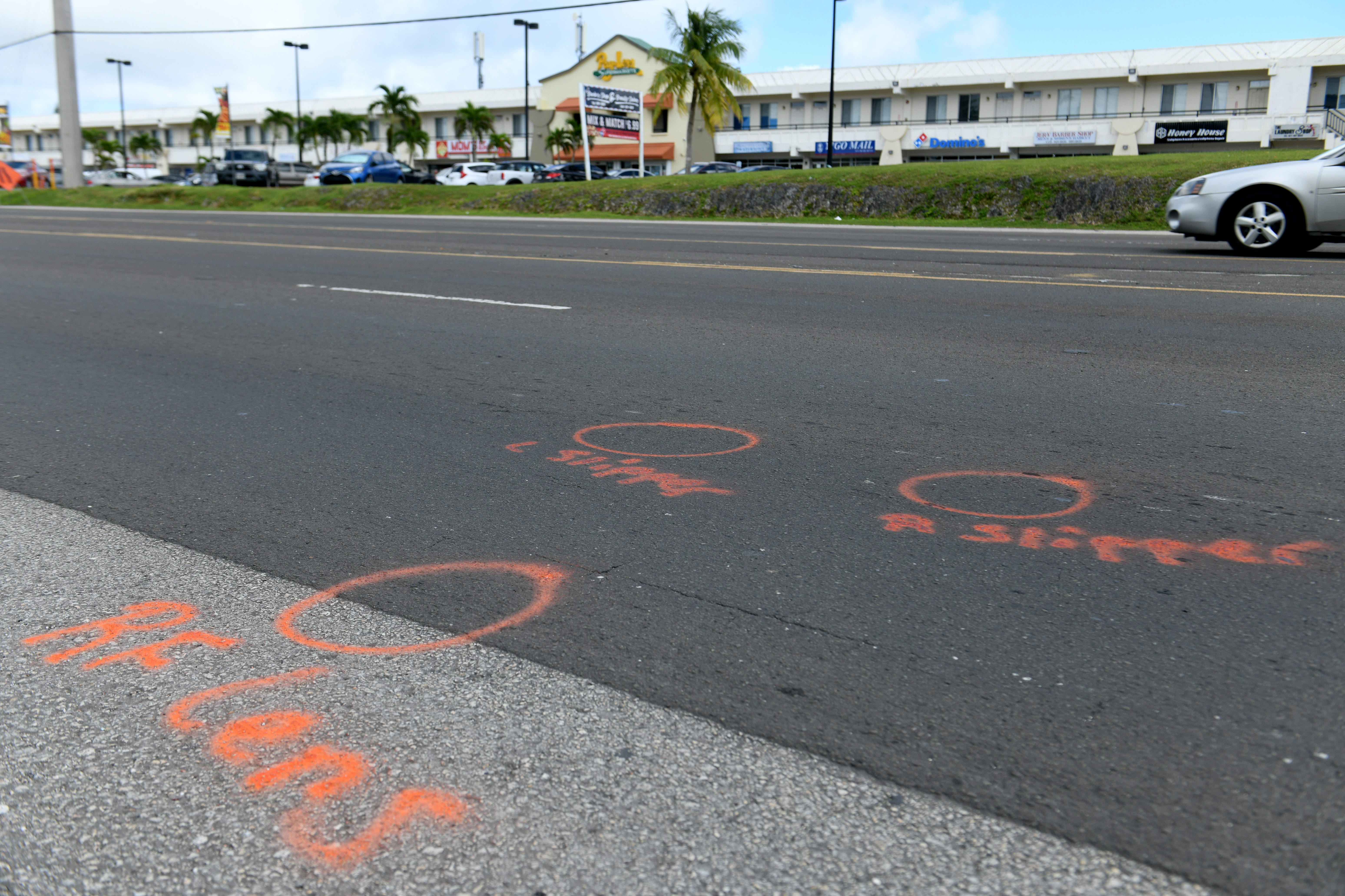 Markings left on the roadway by police, some of which are shown in this Nov. 12, 2018, photo, indicated that Patterson Gallen was struck across Route 1 from the Yigo Pay-Less Supermarket, and ended up more than 100 feet south.