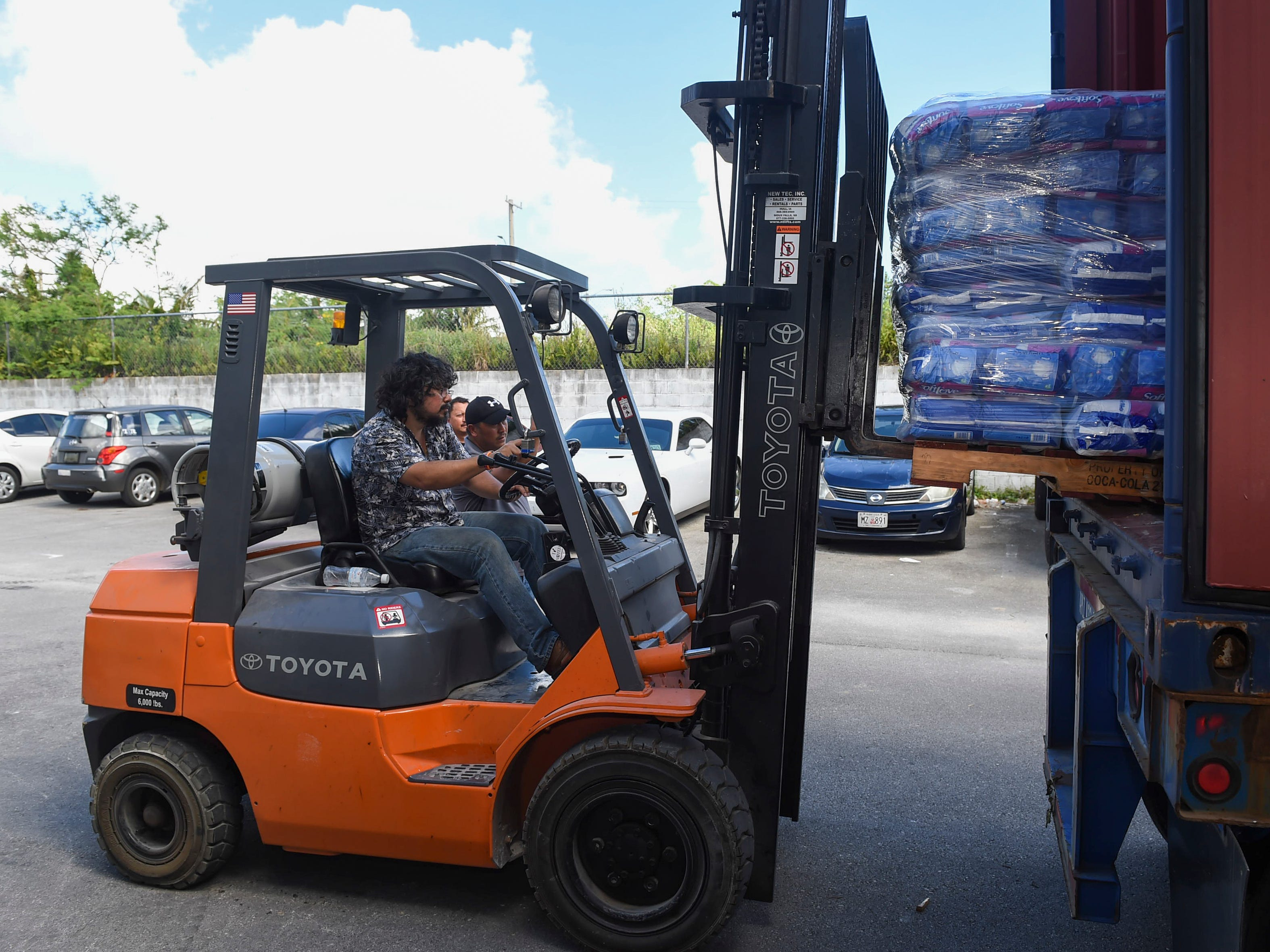 Asia Pacific Wholesalers owner Deepak Dewan loads a pallet of baby diapers into a container of donations for the CNMI at their warehouse in Dededo, Nov. 12, 2018.