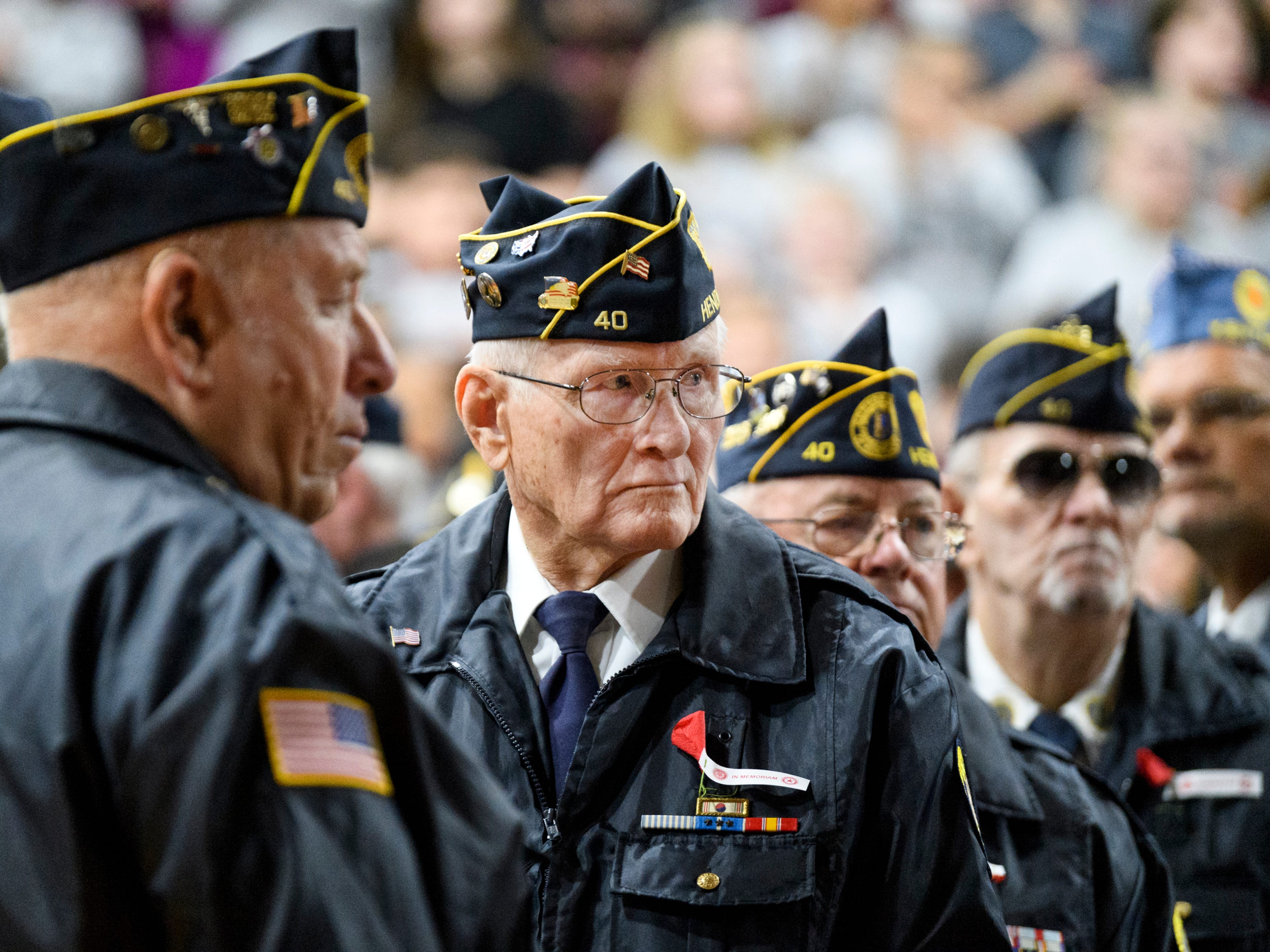 Bob G. Royster, second from left, and other members of the American Legion Worsham Post 40 Honor Guard attend the 38th annual Veteran's Day program at South Middle School in Henderson, Ky., Monday, Nov. 12, 2018.