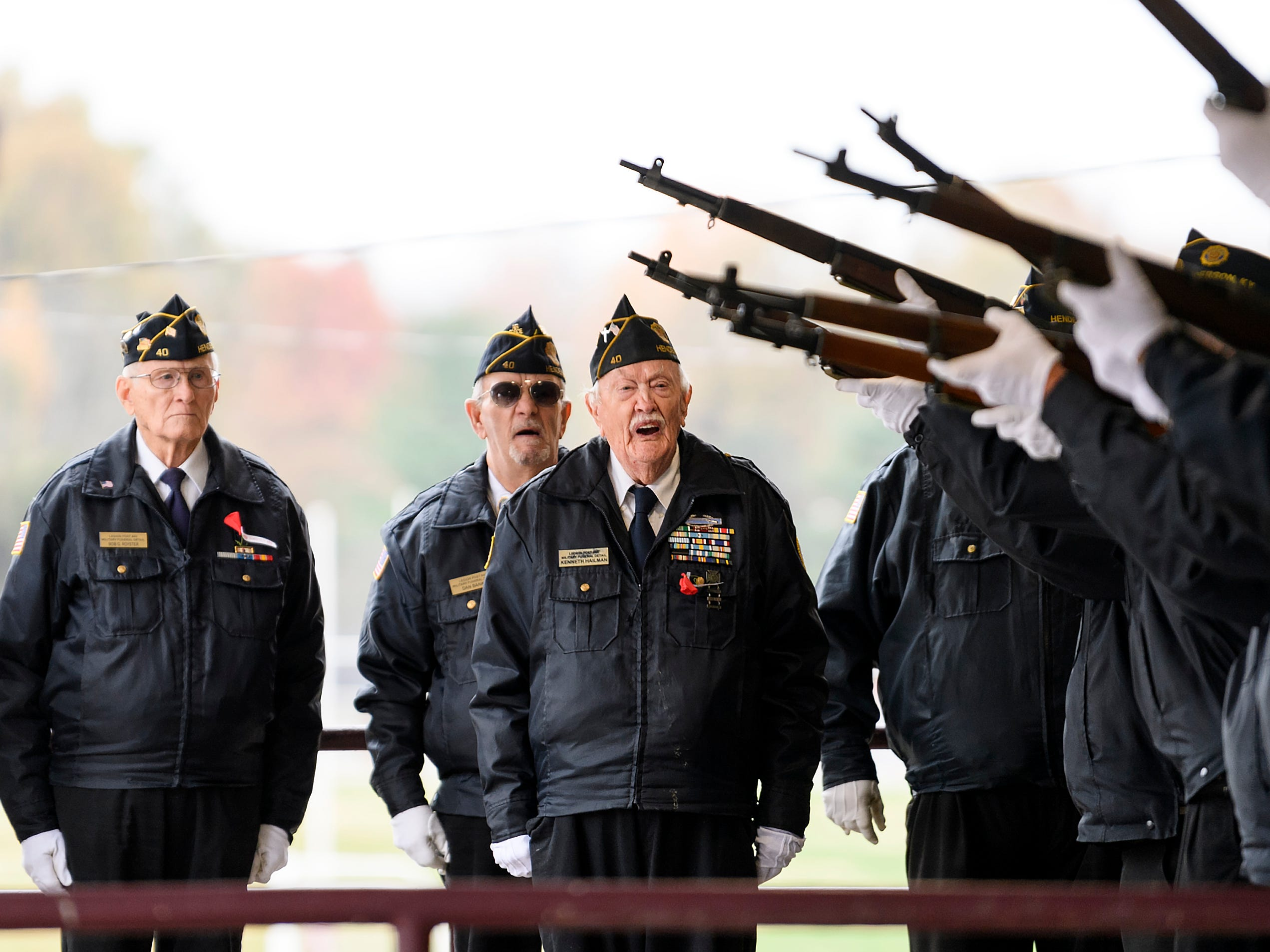 The Henderson American Legion Worsham Post 40 Honor Guard performs a 21-gun salute during the 38th annual Veteran's Day program at South Middle School in Henderson, Ky., Monday, Nov. 12, 2018.