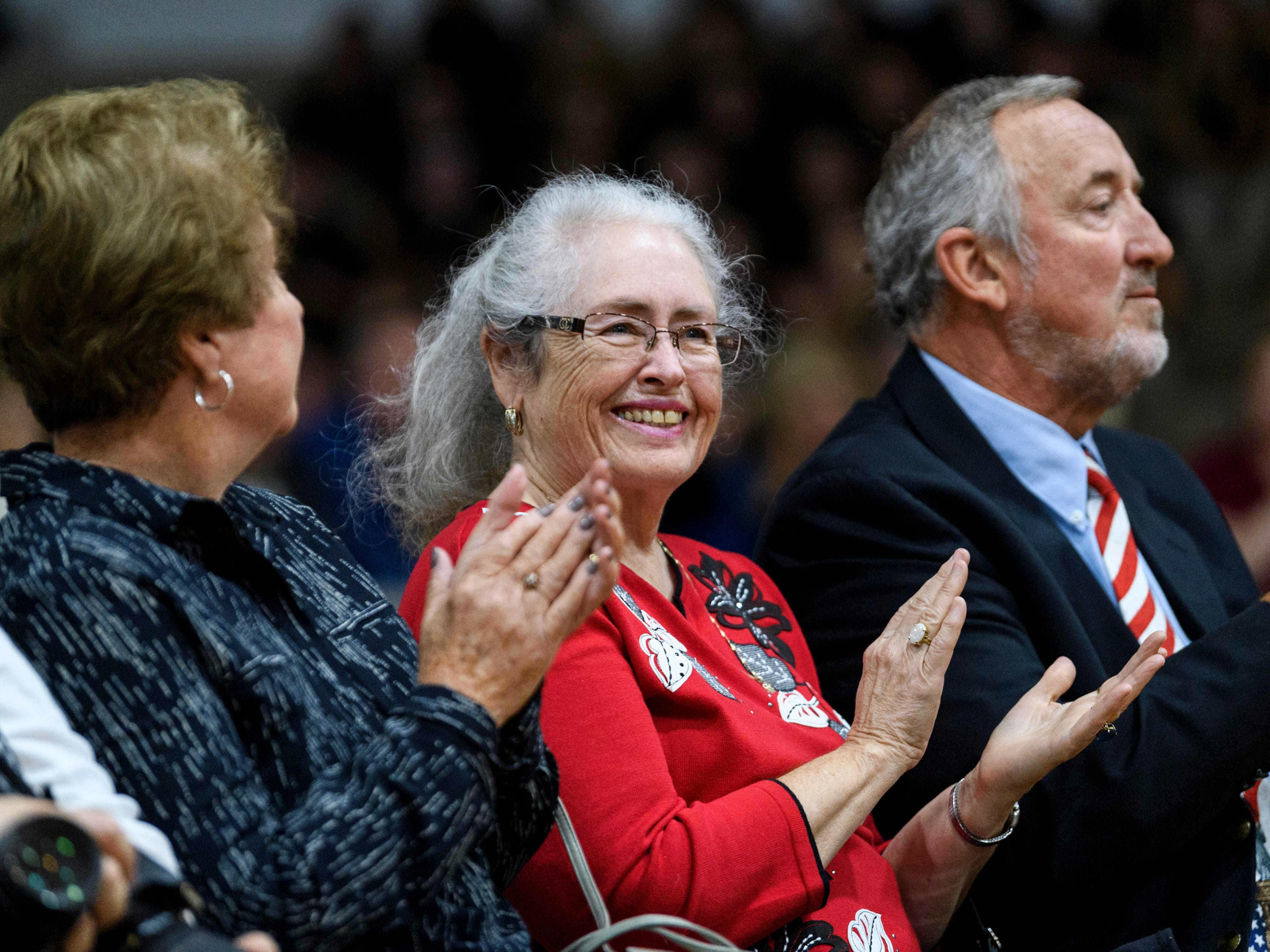 Nancy Jordan, center and David Jordan applaud their son, Justin Jordan, not pictured, as he finishes his speech during the 38th annual Veteran's Day program at South Middle School in Henderson, Ky., Monday, Nov. 12, 2018. David served as the principal of South Middle School for 15 years and Justin attended the school in the 1980s.