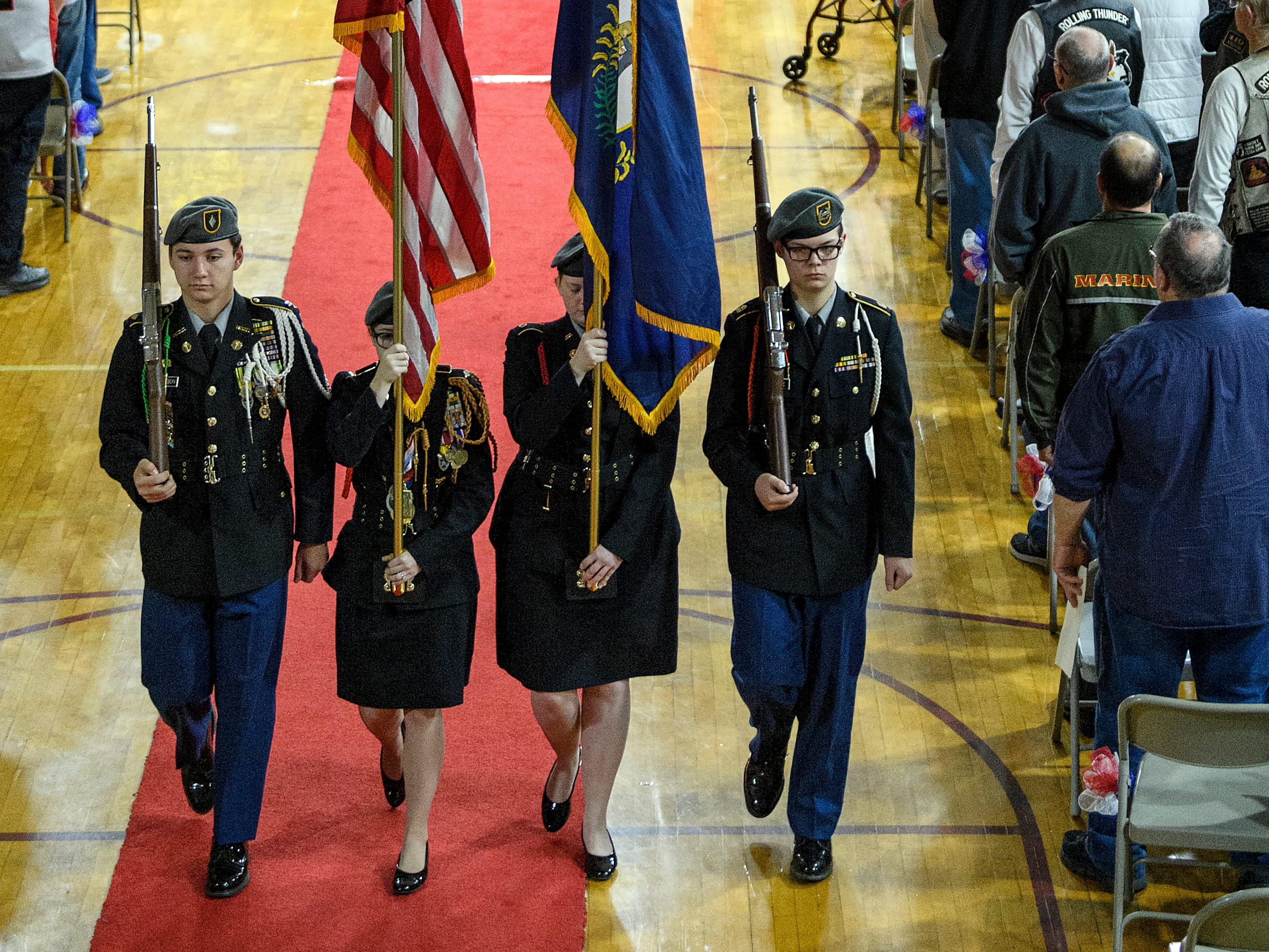 Henderson County Army JROTC Cadet Maj. Noah Wilkerson, from left, Cadet Maj. Kattie Simpson, Cadet Maj. Keleigh Hayden and Cadet Maj. Hayden Wallace retire the colors during the 38th annual Veteran's Day program at South Middle School in Henderson, Ky., Monday, Nov. 12, 2018.