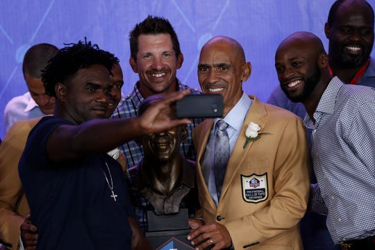 Wayne (right), joins Dallas Clark and Edgerrin James as they honor former teammate Marvin Harrison (far left) and coach Tony Dungy on their Hall of Fame inductions in 2016.