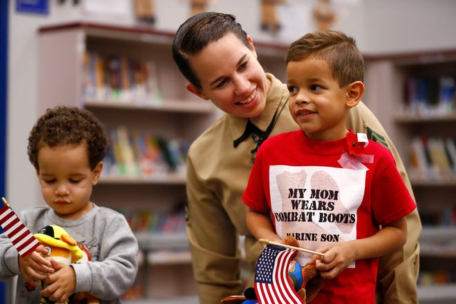 Marine Staff Sgt. Mariah Singleton surprised her son Cameron, right, at his school, Stony Creek Elementary School in Noblesville, during a Veterans Day assembly, Monday, Nov. 12, 2018.  She was reunited with her other son, Quincy, left, earlier in the day, as she came home early from active duty.  The boys had been separated from their mother for about nine months while she was deployed.