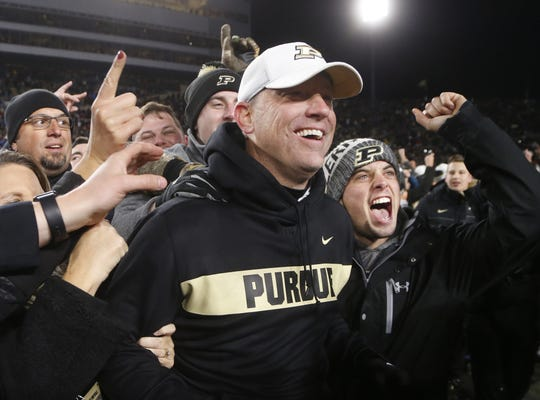Jeff Brohm is mobbed by the Purdue faithful after the Boilermakers upset No. 2 ranked Ohio State 49-20 Saturday, October 20, 2018, at Ross-Ade Stadium.