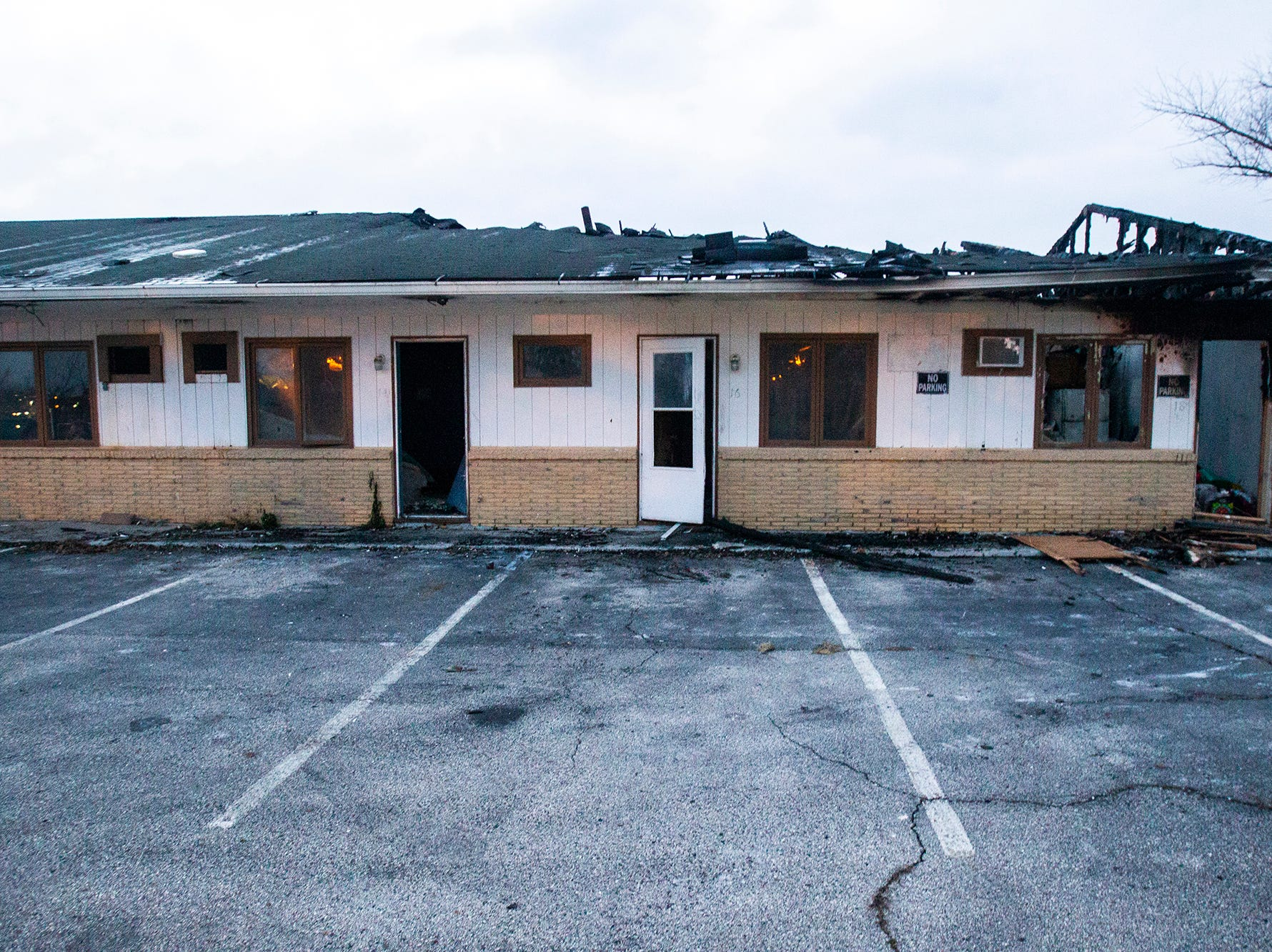 A fire damaged unit is seen on Monday, Nov. 12, 2018, at the former Capri Lodge, 705 2nd St, Coralville.