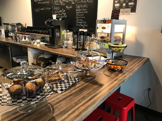 Pastries and fruit are shown inside Good Vibes Cafe in Solon on Nov. 12, 2018.