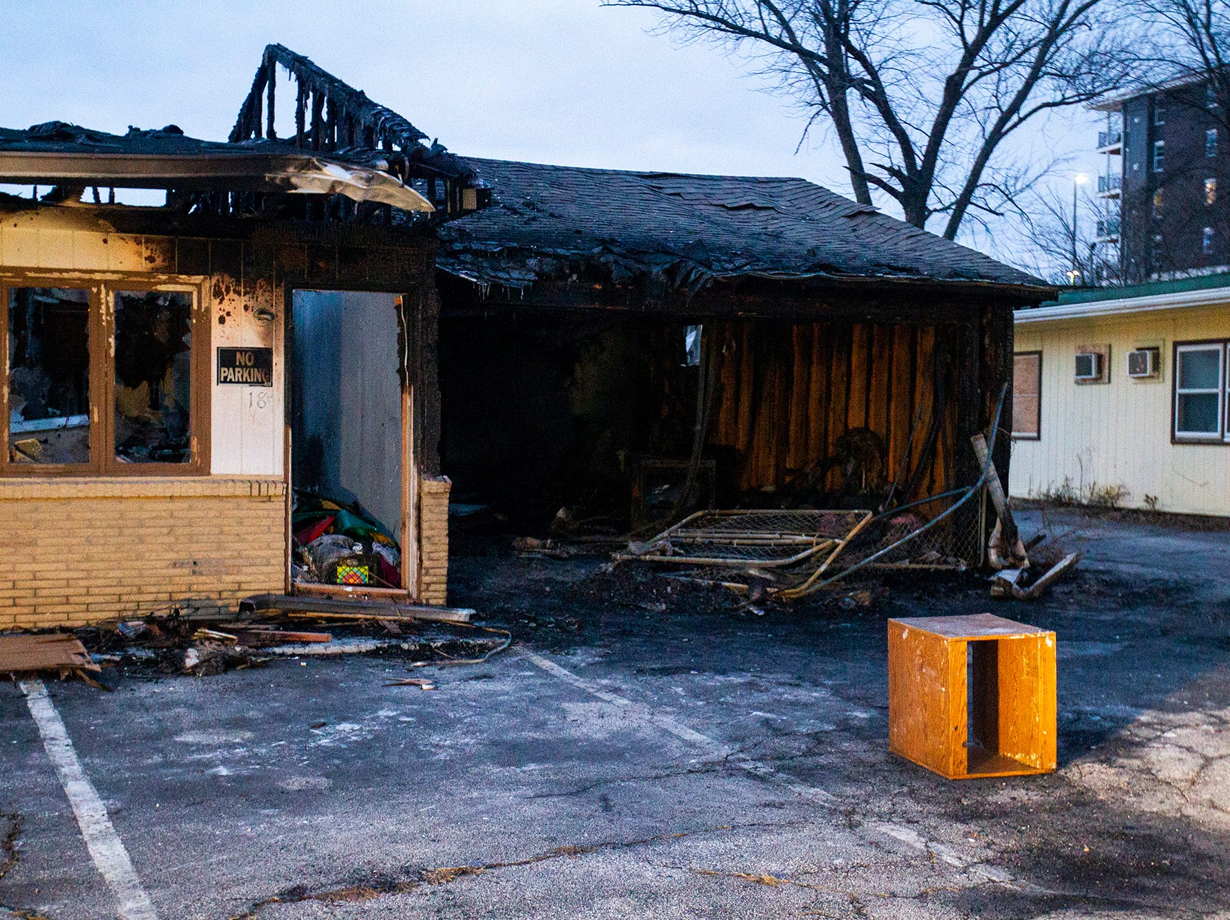 A fire damaged unit is seen on Monday, Nov. 12, 2018, at the former Capri Lodge, 705 2nd St, Coralville. Firefighters were dispatched to the already closed motel complex early Monday morning to extinguish a fire in unit No. 18.