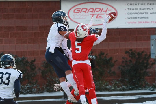 Ithaca College receiver Will Gladney, left, and SUNY Cortland defensive back Max Jean react to a pass in the 2018 Cortaca Jug at Cortland. This year's game will be played Nov. 16 at MetLife Stadium in East Rutherford, New Jersey.