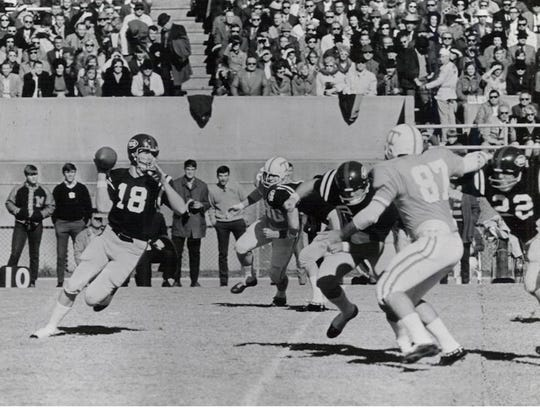 Archie Manning rolls out to throw against   No. 3-ranked Tennessee on Nov. 15, 1969 at Mississippi Veterans Memorial Stadium in Jackson. Ole Miss whipped Tennessee, 38-0.