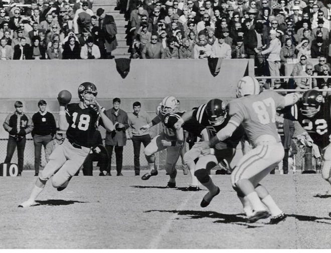 Archie Manning rolls out to throw against  No. 3-ranked Tennessee on Nov. 15, 1969, at Mississippi Veterans Memorial Stadium in Jackson. Ole Miss defeated Tennessee, 38-0.