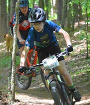 Wyatt Hicks, 14, of Flowood has pedaled his way into the top ten in three races during his two years with the Mississippi Blues Composite Mountain Bike Team.