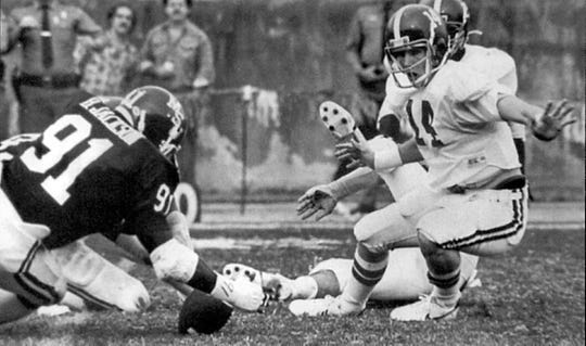 Mississippi State defensive end Billy Jackson (91) recovers the game-clinching fumble in the final seconds of the Bulldogs' 6-3 upset of No. 1-ranked Alabama on Nov. 1, 1980 at Mississippi Veterans Memorial Stadium in Jackson. Alabama had won 28 consecutive games entering the contest.