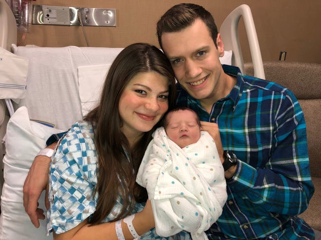 """Bringing Up Bates"" stars Tori and Bobby Smith hold their son Kade, who was born on Friday, Nov. 9, in Nashville."