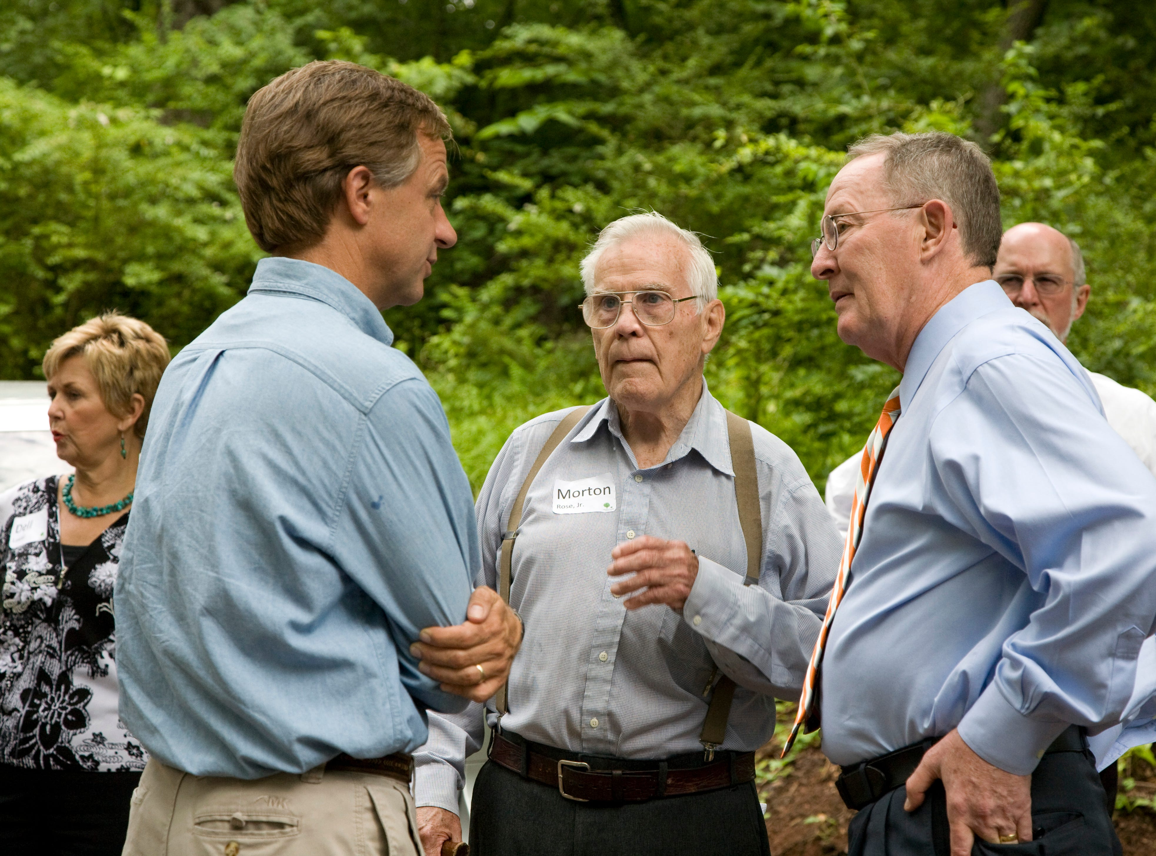 Knoxville Mayor Bill Haslam, left, and Sen. Lamar Alexander, right, speak with Morton Rose, Jr., center, at the River Bluff Wildlife Area Wednesday, May 27, 2009.  Rose grew up on the property and has family ties there dating back to 1915.
