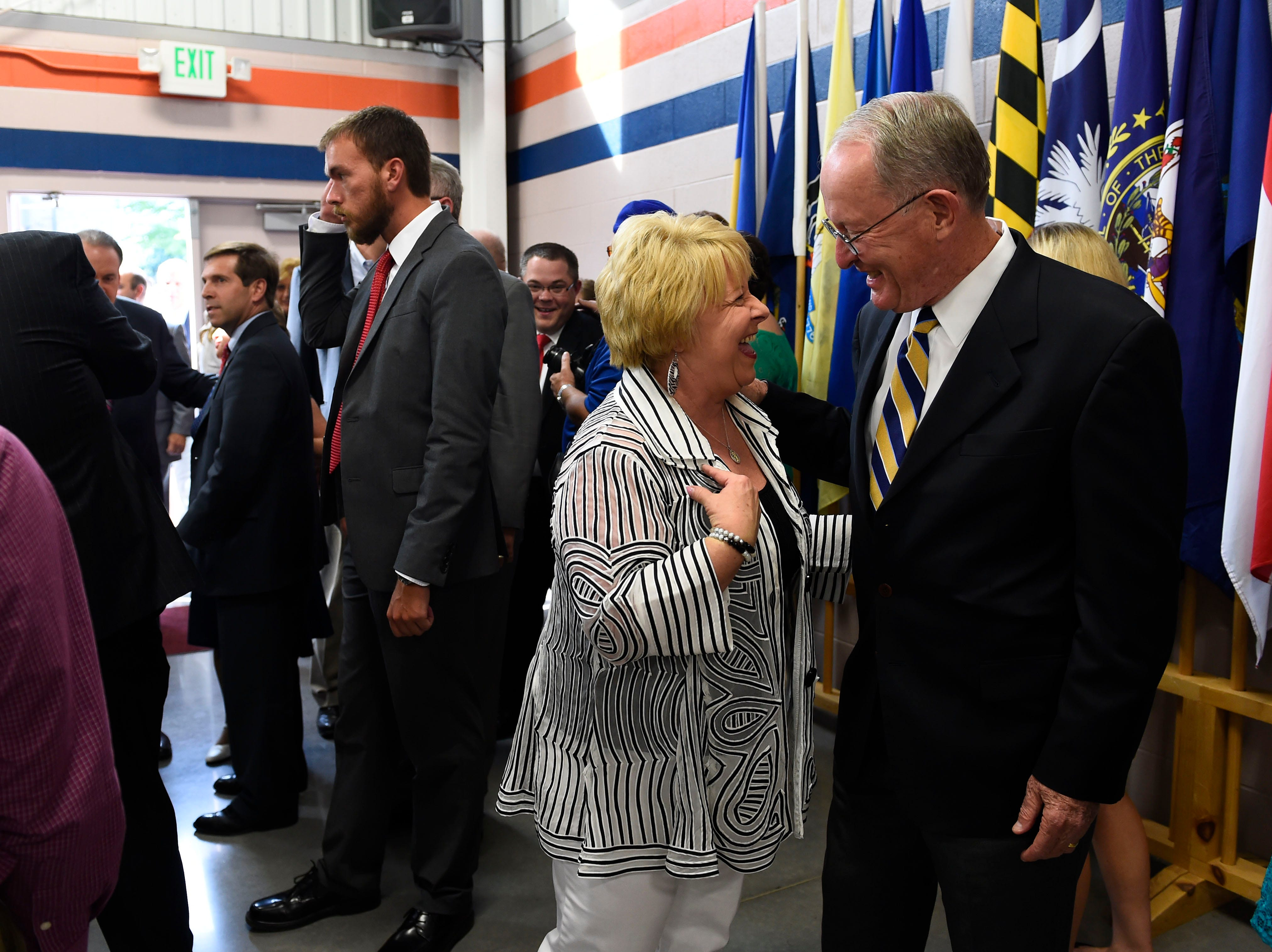 Ann Ayers greets U.S. Sen. Lamar Alexander during the Lincoln Reagan Dinner at Campbell County High School in LaFollette, Saturday, July 12, 2014.