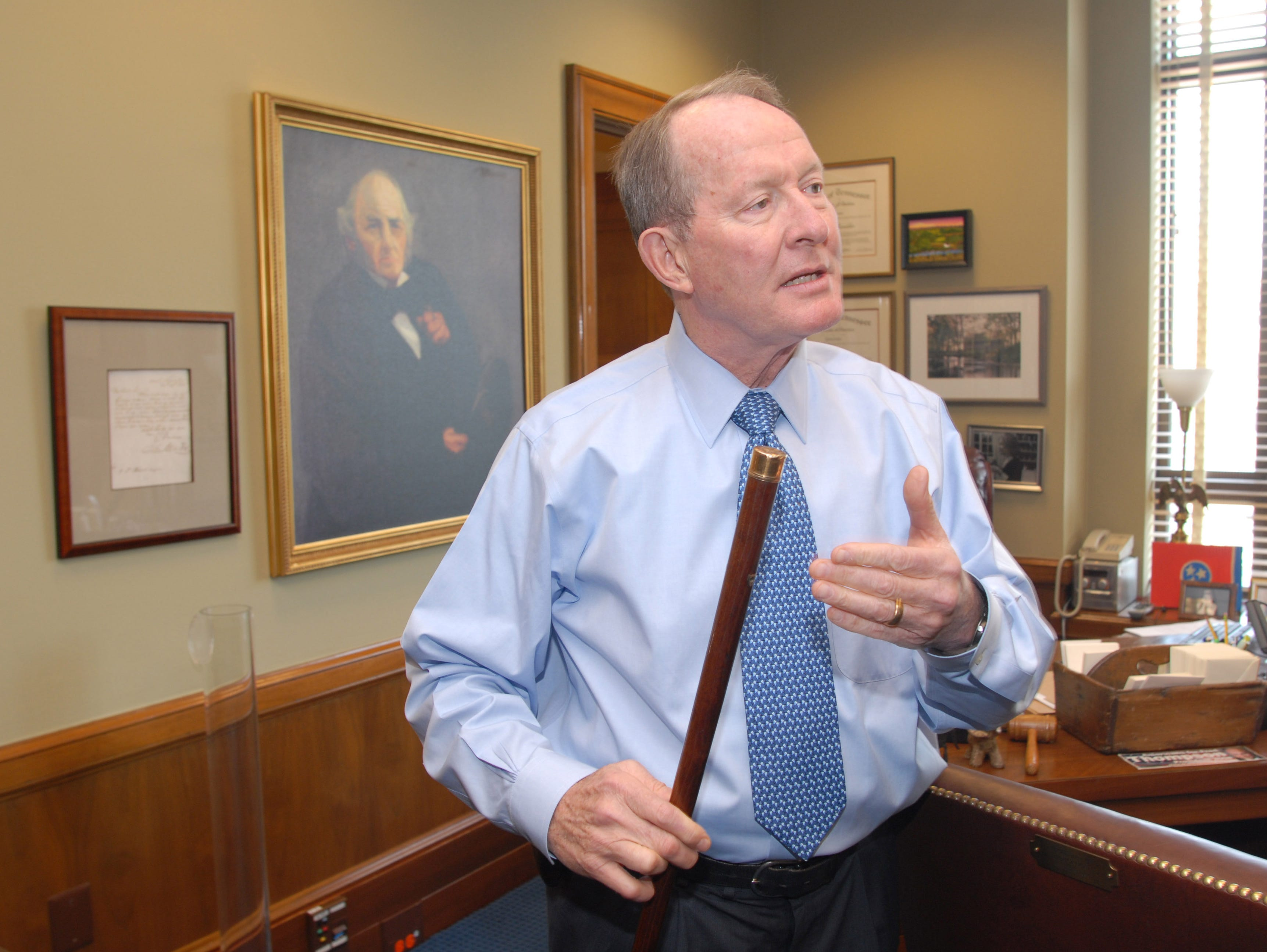 U.S. Senator Lamar Alexander talks in his DC office about his ownership of an antique walking stick once owned by Sam Houston. He's holding the cane.