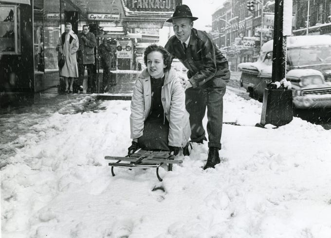 Sledding down Gay St. in downtown Knoxville in February 1960.