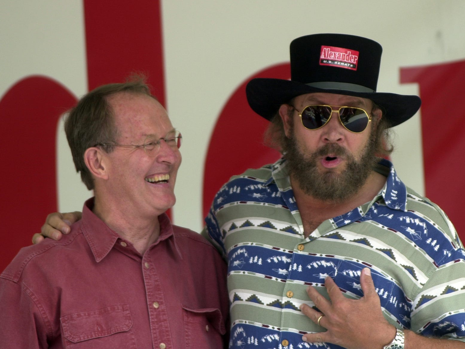 Country singer Hank Williams Jr., right, hams it up with U.S. Senate candidate Lamar Alexander during a rally Sunday, July 21, 2002, at the Museum of Appalachia. Alexander is running against U.S. Rep. Ed Bryant in the Republican primary for the U.S. Senate.