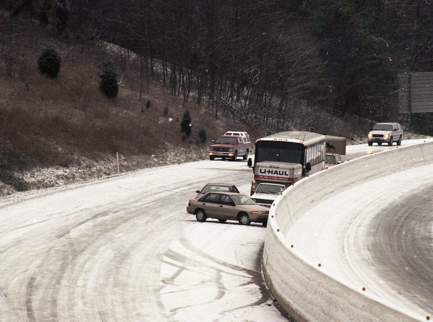Cars, trucks and buses were stuck on I-75 between Emory Road and Racoon Valley Road in January 1996 when a light snow compacted to ice and caused vehicles to slide.
