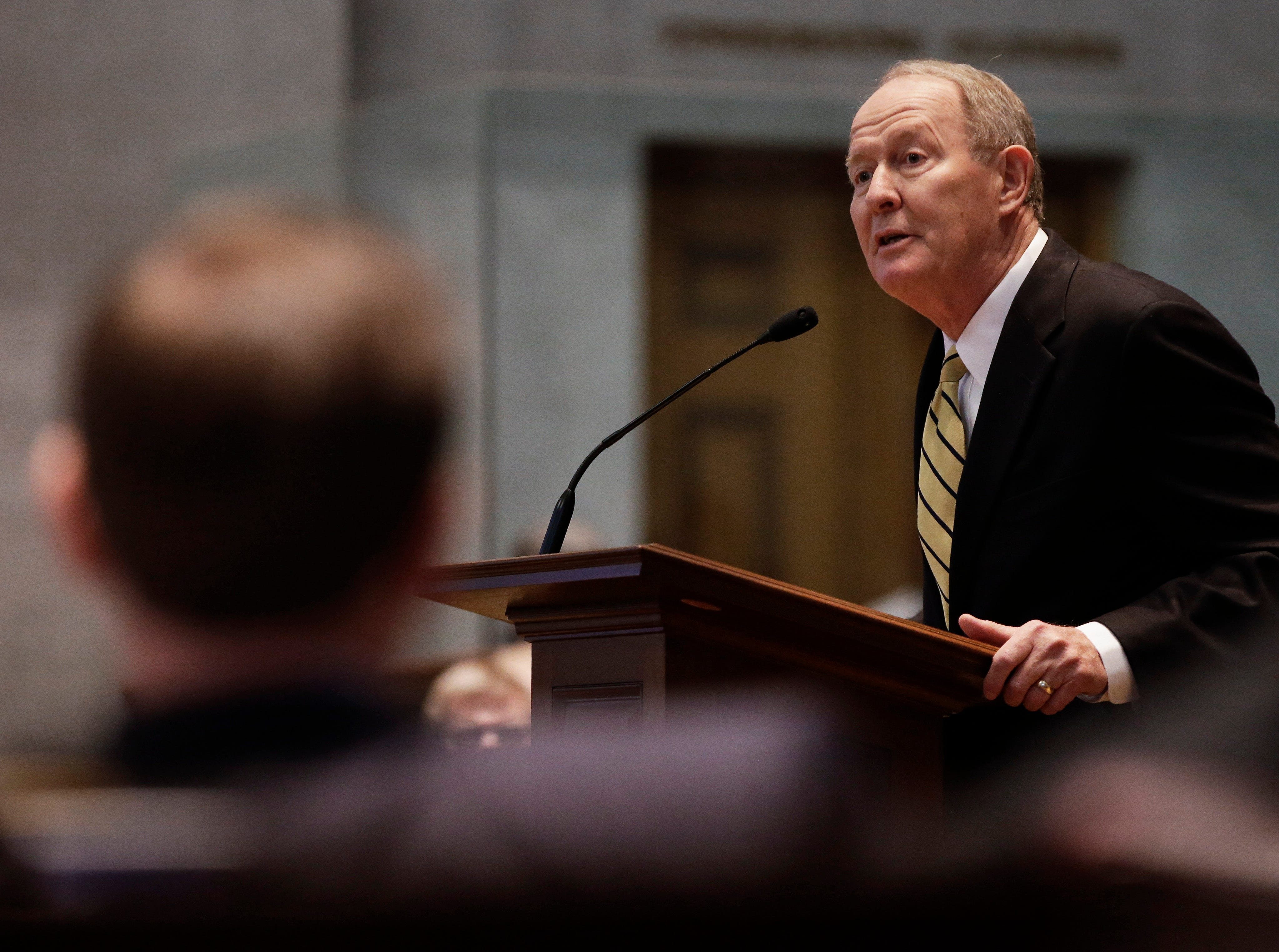 Sen. Lamar Alexander, R-Tenn., speaks to a joint session of the Tennessee General Assembly on Wednesday, Jan. 9, 2013, in Nashville, Tenn. Alexander is proposing a Ògrand swapÓ in which the federal government would take over all responsibility for Medicaid and the states would gain all control over education.
