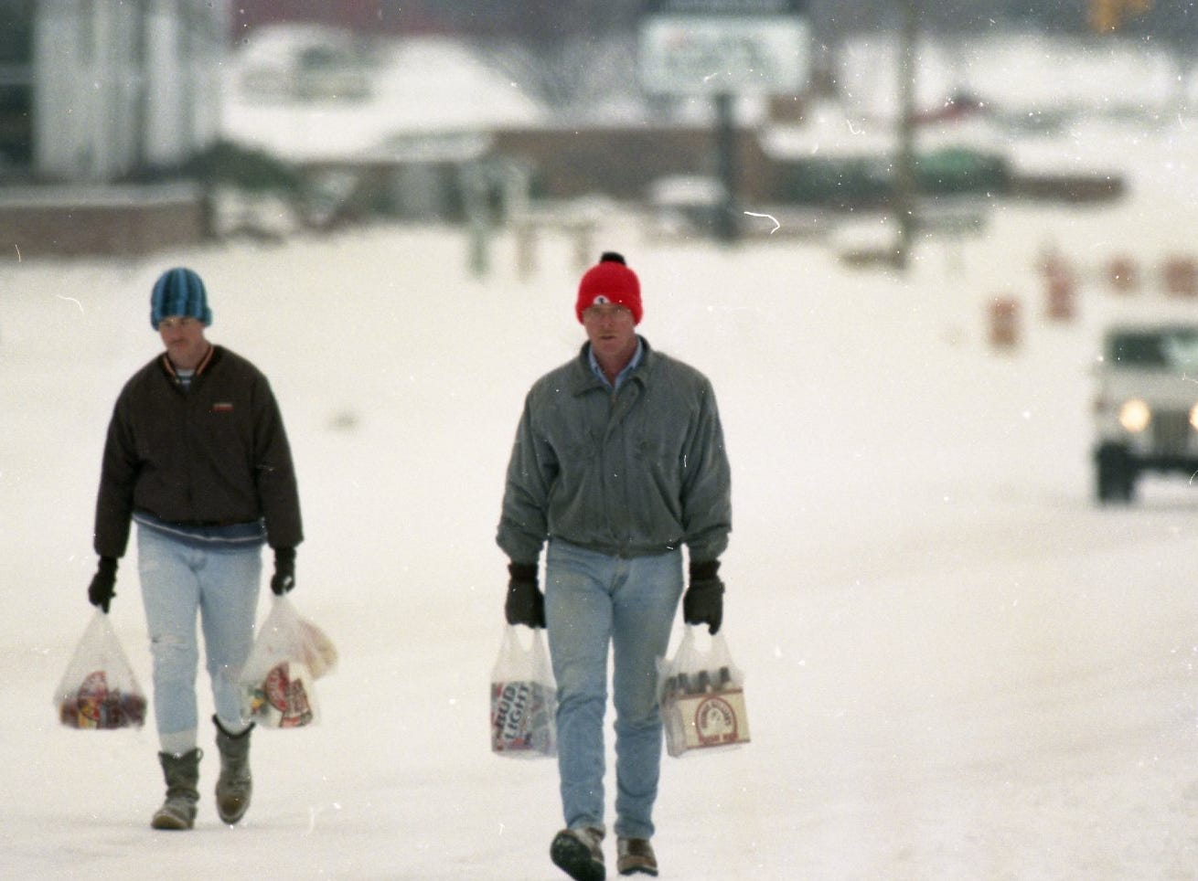 Matt and Mark Howell walked four miles in the snow to get essentials at a store on Kingston Pike in February 1996. They are walking back to their home on Peters Road.