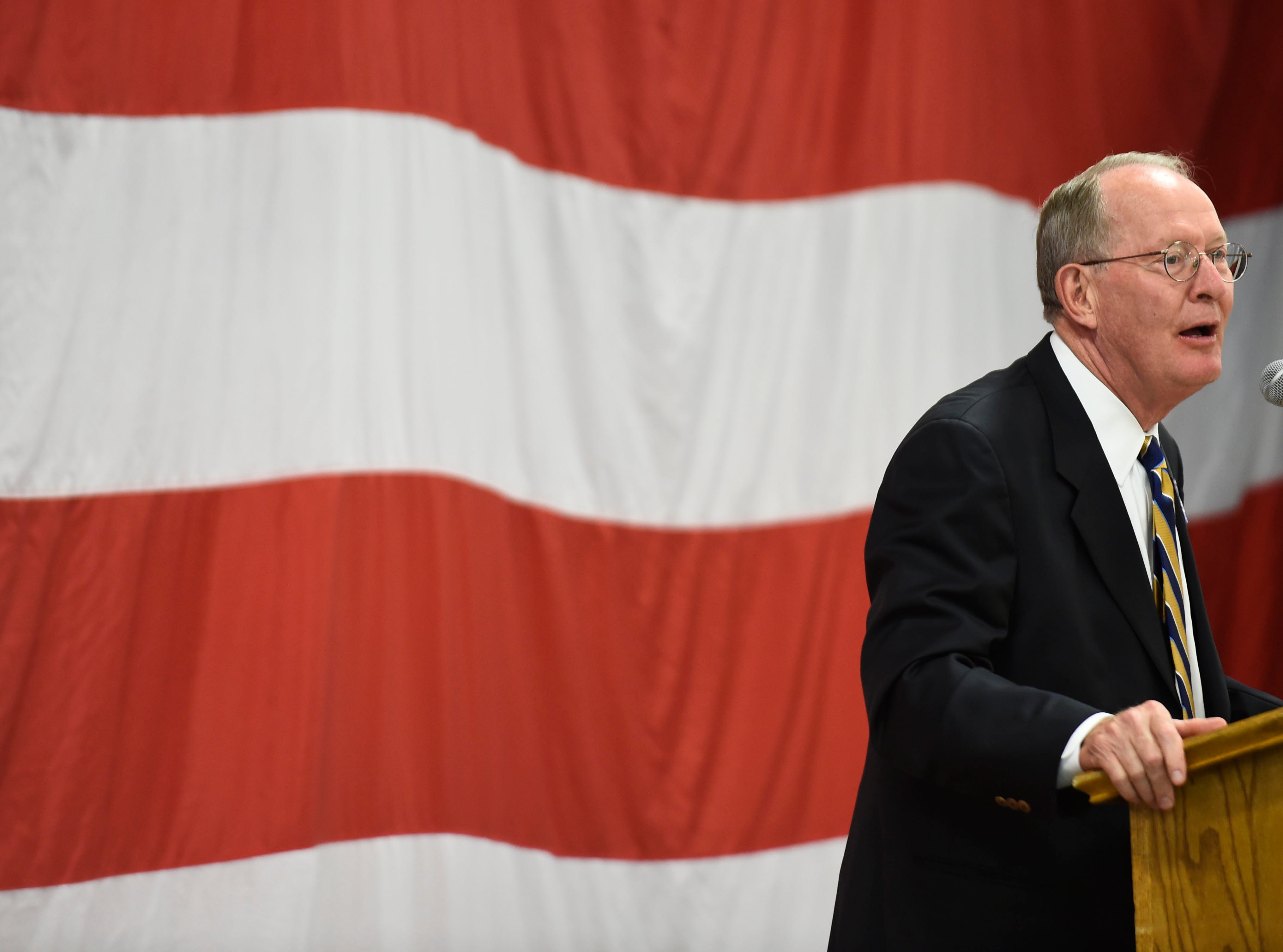 U.S. Sen. Lamar Alexander addresses the crowd during the Lincoln Reagan Dinner at Campbell County High School in LaFollette, Saturday, July 12, 2014.