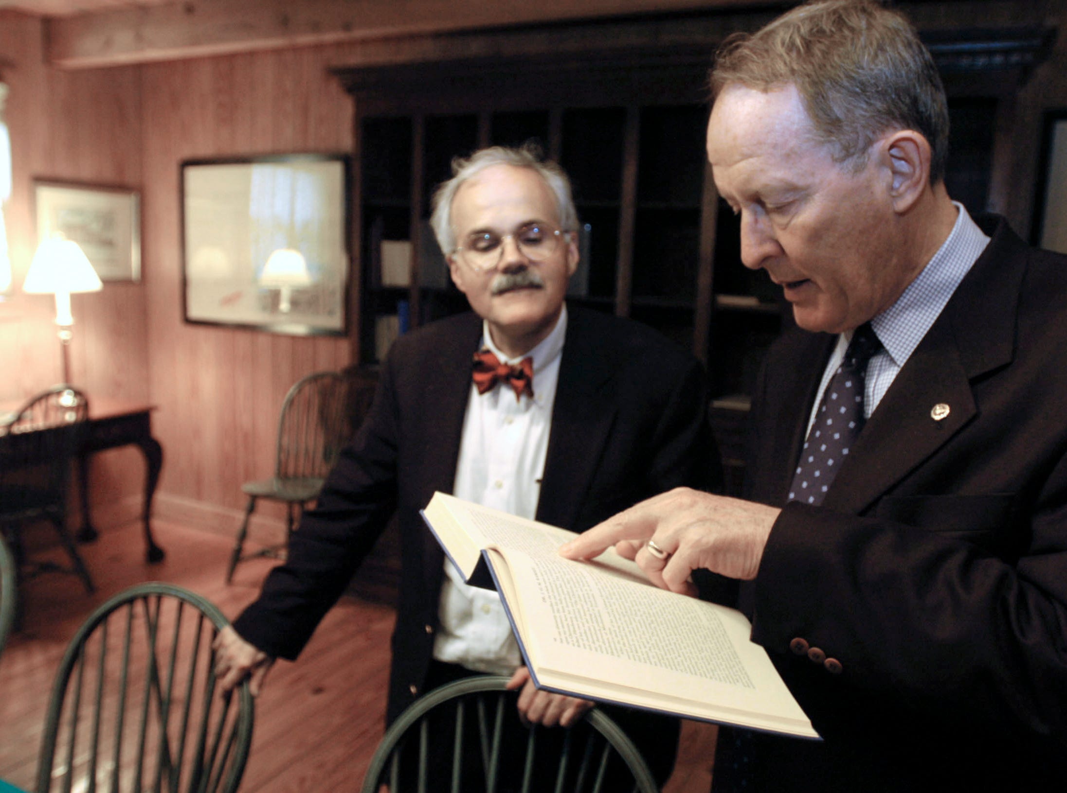 U.S. Sen. Lamar Alexander, R-Tenn., reads a passage from a book in the library named after his fourth-great-grandfather, John W. Alexander. The passage relates the story of his grandfather's visit to the Ramsey House in Knox County, built by his nephew, Francis Alexander Ramsey in 1797. Lamar Alexander, former Tennessee governor, also toured the stately home with David Duncan, left, president of the Ramsey House Plantation Board of Directors. Francis Ramsey brought his uncle to live on the plantation and built him a cabin, represented now by the library established in 1990 by Lamar Alexander to honor John Alexander.      5/24/2004
