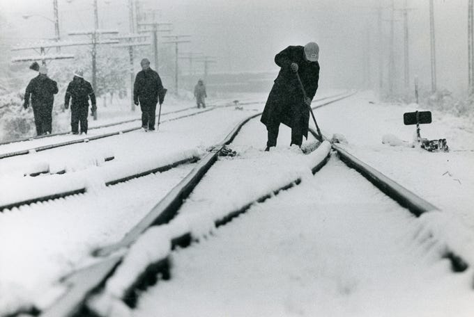 CSX transportation crews sweep off switches along train tracks near Kingston Pike at the west entrance to UT in January 1987.