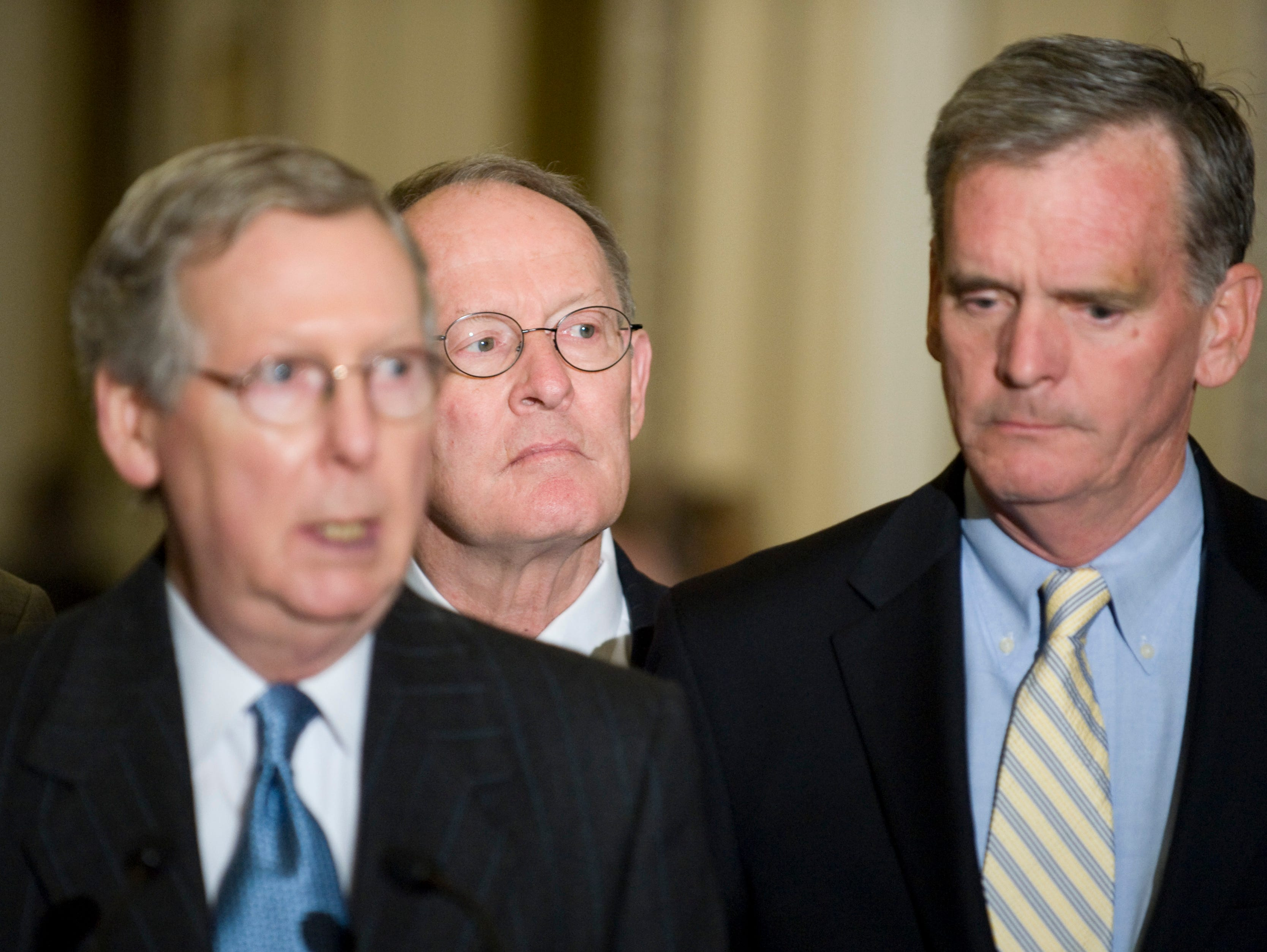 Sen. Lamar Alexander, R-Tenn., flanked by Senate Minority Leader Mitch McConnell, R-Ky., left, and Sen. Judd Gregg, R-N.H., for the Senate Republican leaders' weekly news conference following the Senate Republican Policy Luncheon on Tuesday, May 20, 2008.