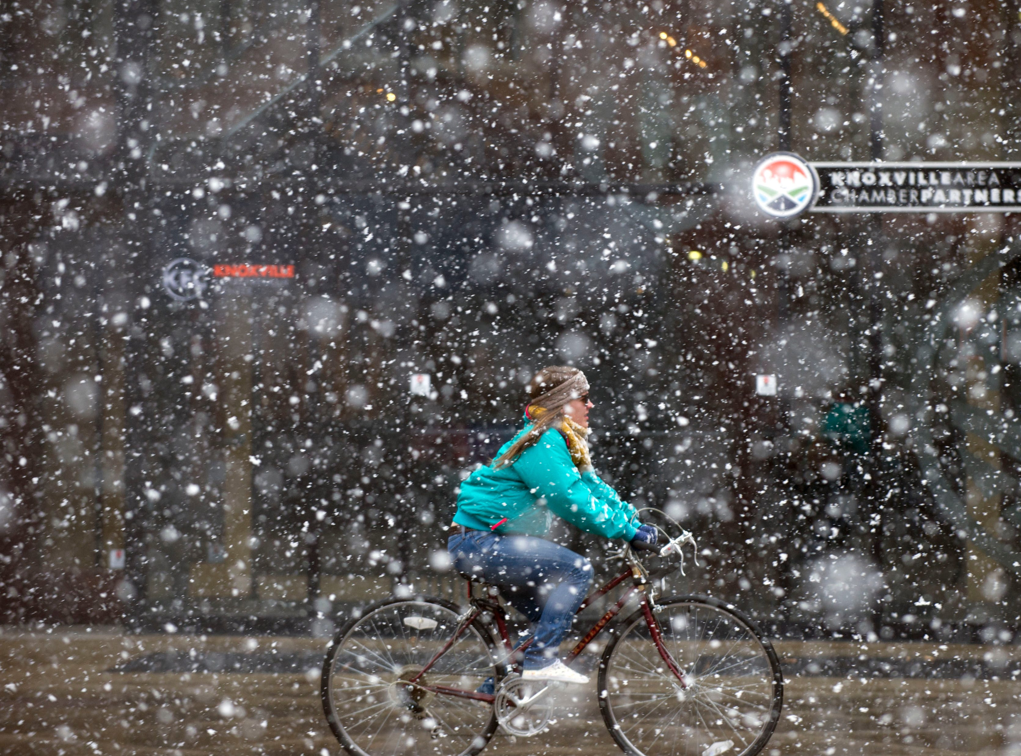 A bicyclist rides across Market Square Mall on Wednesday, February 12, 2014. The national weather service is predicting a possible accumulation of  5 to 9 inches inches of snow.
