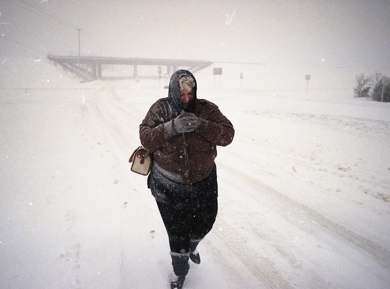 Dotty Hunter, who was stranded at work, walks home on Emory Road in March 1993. Hunter, who was traveling east on Emory Road just east of the I-75 interchange, said she wanted to get home to her two teenaged children.